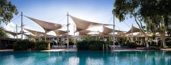 Ayers rock resort with pool and shade sails